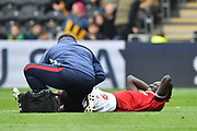 Bristol City striker Famara Diedhiou (9) is injured during the EFL Sky Bet Championship match between Hull City and Bristol City at the KCOM Stadium, Kingston upon Hull, England on 5 May 2019.