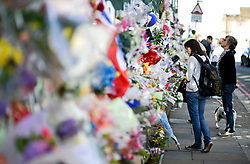 © London News Pictures. 26/05/2013. Woolwich, UK. Members of the public lay flowers a pay their respects at the scene where Drummer Lee Rigby was murdered by two men in Woolwich town centre in what is being described as a terrorist attack. Photo credit: Ben Cawthra/LNP