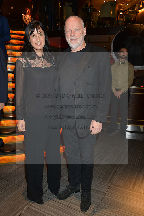 DAVID GILMOUR and POLLY SAMSON at the 2014 Costa Book of The Year Awards held at Quaglino's, Bury Street, London on 27th January 2015.  The winner of the Book of The Year was Helen Macdonald for her book H is for Hawk.