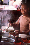 01 DECEMBER 1988  - HONG KONG: Vendor selling fresh soup in the night market on Hong Kong. PHOTO © JACK KURTZ  FOOD  ECONOMY