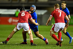Gianmarco Lucchesi of Italy is tackled by Morgan Strong of Wales <br /> <br /> Photographer Craig Thomas/Replay Images<br /> <br /> U20 Six Nations - Wales v Italy  - Friday 31st January 2020 - Stadiwm Zip World (Parc Eirias) - Colwyn Bay<br /> <br /> World Copyright © Replay Images . All rights reserved. info@replayimages.co.uk - http://replayimages.co.uk