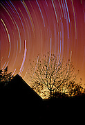 Star trails over a Pretoriuskop Camp guesthouse, Kruger National Park, South Africa