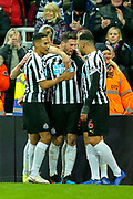 Fabian Schar (#5) of Newcastle United celebrates Newcastle United's second goal (2-0) with Newcastle United team mates during the Premier League match between Newcastle United and Cardiff City at St. James's Park, Newcastle, England on 19 January 2019.
