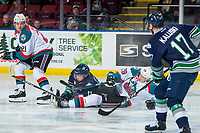 KELOWNA, CANADA - JANUARY 30:  Nolan Foote #29 of the Kelowna Rockets collides with Keltie Jeri-Leon #11 of the Seattle Thunderbirds on January 30, 2019 at Prospera Place in Kelowna, British Columbia, Canada.  (Photo by Marissa Baecker/Shoot the Breeze)