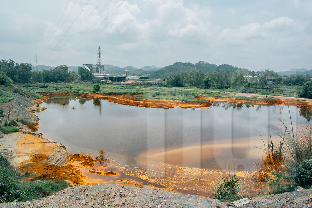 Polluted lake in front of a coal-fired-power plant, Na Duong, Lang Son Province, Vietnam, Southeast Asia