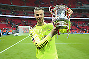 David De Gea of Manchester United with the FA Cup during the The FA Cup Final between Crystal Palace and Manchester United at Wembley Stadium, London, England on 21 May 2016. Photo by Phil Duncan.