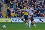 Bradford City striker Billy Clarke (10) and Oxford United midfielder Joshua Ruffels (14) battle for possession 0-0 during the EFL Sky Bet League 1 match between Oxford United and Bradford City at the Kassam Stadium, Oxford, England on 15 October 2016. Photo by Alan Franklin.