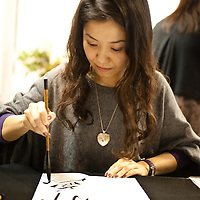 Milan, Italy - February  17:  A Japanese woman writes japanese characters at BIT International Tourism Exchange on february 17, 2012 in Milan, Italy.