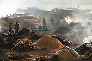 Wood charcoal production site on the outskirts of San Pedro, Bas-Sassandra region, Côte d'Ivoire on Sunday March 4, 2012. Men, women and children - who don't go to school - work here seven days a week.