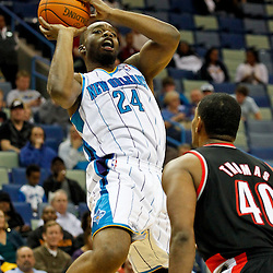 January 16, 2012; New Orleans, LA, USA; New Orleans Hornets power forward Carl Landry (24) shoots over Portland Trail Blazers center Kurt Thomas (40) during the first quarter of a game at the New Orleans Arena.   Mandatory Credit: Derick E. Hingle-US PRESSWIRE