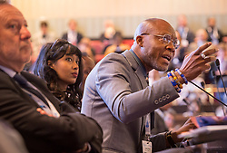 © Licensed to London News Pictures. 22/10/2018. Bristol, UK. Global Parliament of Mayors Annual Summit, 21-23 October 2018, at Bristol City Hall. Picture of IDDRISU MUSAH, Mayor of Tamale, Ghana, taking part in the plenary session on harnessing the power of migration. The Global Parliament of Mayors 2018 is the biggest and most ambitious Annual Summit to date. GPM Bristol 2018 will host up to 100 global mayors for an action-focused summit that addresses some of the biggest challenges facing today's world cities. GPM Bristol 2018's theme, Empowering Cities as Drivers of Change, will focus minds on global governance and the urgent need for the influence, expertise and leadership of cities to be felt as international policy is shaped. GPM Bristol 2018 will provide mayoral delegates with a global network of connections and a space to develop the collective city voice necessary to drive positive change. The programme will engage participants in decision-making, with panels, debate and voting on priority issues including migration and inclusion, urban security and health, and is a unique chance to influence decisions on the most pressing issues of our time. Photo credit: Simon Chapman/LNP
