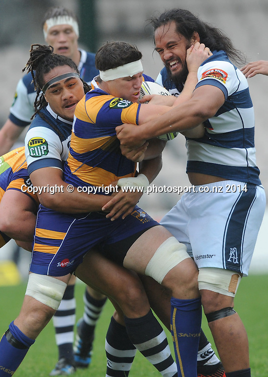 Bay of Plenty's Calum Retallick is tackled by Auckland's Ofa Tu'ungafasi and William Lloyd in the ITM Cup rugby match, Bay of Plenty vs Auckland, Rotorua International Stadium, Rotorua, September 13, 2014. Photo: Kerry Marshall / photosport.co.nz