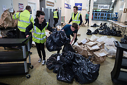 © Licensed to London News Pictures . 07/05/2015 . Doncaster , UK . Ballots are rushed in to the counting hall and sorted . The count for the 2015 General Election in Labour Party leader Ed Miliband's constituency of Doncaster North , at Doncaster Racecourse . Photo credit : Joel Goodman/LNP