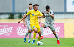 Matej Podlogar of Domzale vs Luka Menalo of Olimpija during football match between NK Domzale and NK Olimpija in 29th Round of Prva liga Telekom Slovenije 2019/20, on June 21, 2020 in Sports park, Domzale, Slovenia. Photo by Vid Ponikvar / Sportida