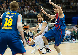 © Licensed to London News Pictures. 10/05/2013. London, UK.  Real Madrid (white strip) play and beat FC Barcelona (blue/purple strip) in Semi-Final B of the Euroleague Basketball Final Four at The O2 Arena.   Real Madrid will go on to play in the final on Sunday.  The Turkish Airlines Euroleague, commonly known as the Euroleague, is the highest level tier and most important professional club basketball competition in Europe, with teams from up to 18 different countries, members of FIBA Europe. Photo credit : Richard Isaac/LNP