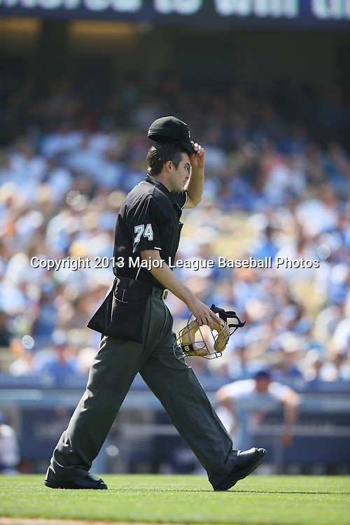 LOS ANGELES, CA - APRIL 28:  home plate umpire John Tumpane #74 walks to the pitcher's mound during the game against the Milwaukee Brewers on Sunday, April 28, 2013 at Dodger Stadium in Los Angeles, California. The Dodgers won the game 2-0. (Photo by Paul Spinelli/MLB Photos via Getty Images) *** Local Caption *** John Tumpane