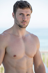 shirtless good looking man with blue eyes and brown hair outdoors