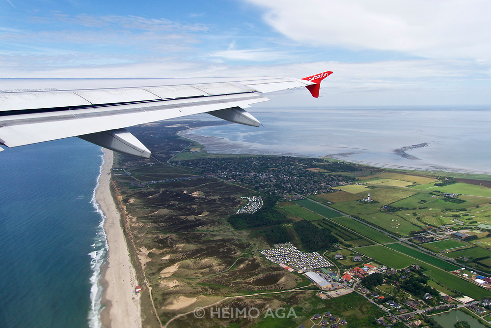 Sylt, Germany. Starting from Westerland Airport aboard an Air Berlin Airbus A320 to Düsseldorf. The beach at the Red Cliff at Kampen (background. l.) and Wenningstedt-Braderup (foreground r.).