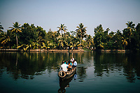 Alleppey, India -- February 20, 2018: A cross-river ferry service on the backwaters outside of Alleppey in southern India.