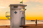 Girl Taking A Selfie At Laguna Beach Lifeguard Tower During Sunset