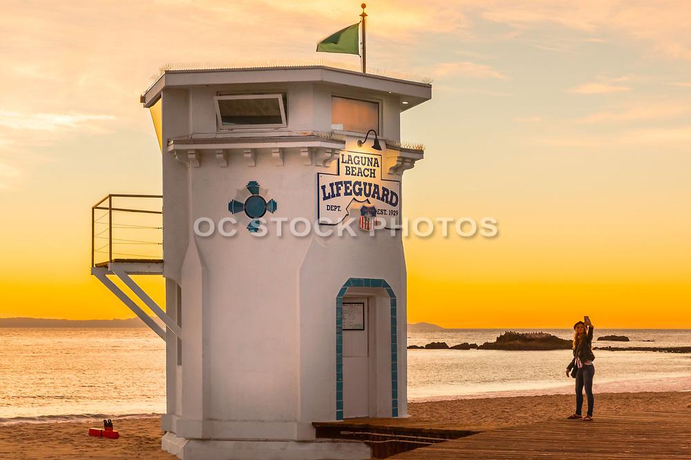 Girl Taking A Selfie At Laguna Beach Lifeguard Tower During Sunset