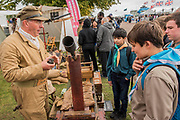 Royal Flying Corp re-enactors show some kit to a group of scouts - Duxford Battle of Britain Air Show taking place during IWM (Imperial War Museum) Duxford's centenary year. Duxford's principle role as a Second World War fighter station is celebrated at the Battle of Britain Air Show by more than 40 historic aircraft taking to the skies.