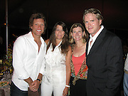 Jon Bon Jovi with wife Dorothea Bon Jovi, Mercy Corps President, Nancy Lindborg, Take Note Co-Founder, activist and British Actor Cary Elwes.Music For Mercy Corps Hamptons Benefit for Darfur Hosted by Cary Elwes and Sarah Silverman.Tuscan Villa.Water Mill, NY, United States .Saturday, August 23, 2008.Photo By Celebrityvibe.com.To license this image call (212) 410 5354 or;.Email: celebrityvibe@gmail.com; .Website: www.celebrityvibe.com.