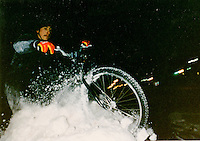 Andy Gregg riding a snowbank in Marquette, MI, 1995.  Photo by Joe Welsh.