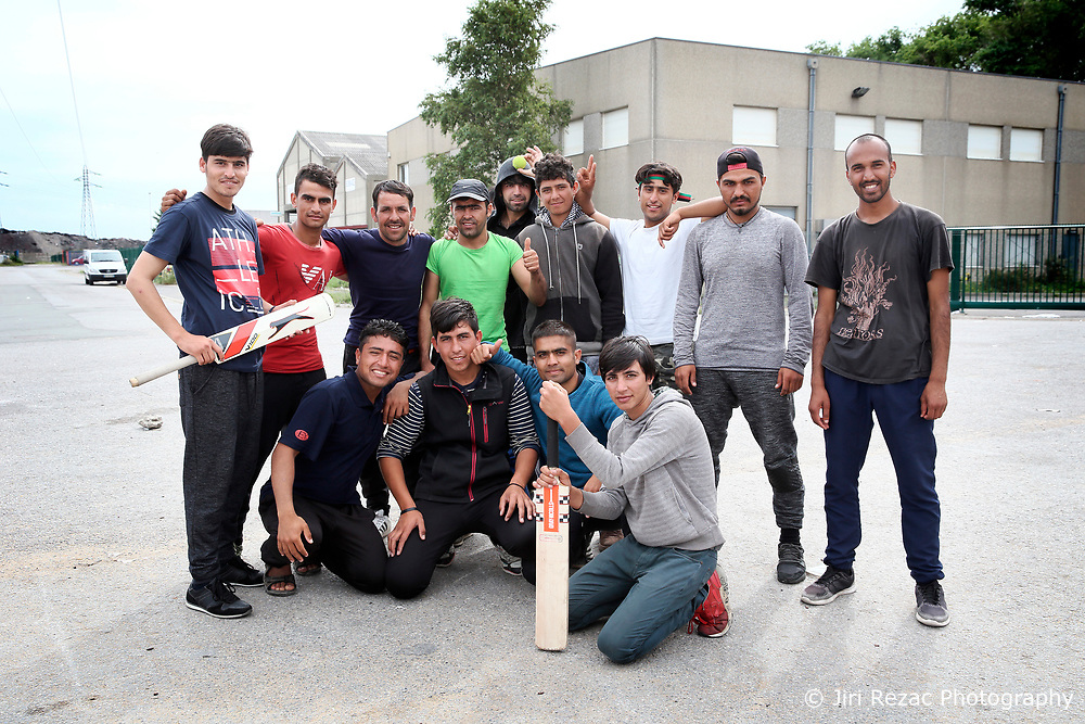 FRANCE CALAIS 2AUG17 - Rehan Barakzai, 16, from Kunduz, Afghanistan poses for a photo with his fellow Afghan cricket players at an industrial estate in Calais, northern France.<br /> <br /> He has traveled to Europe for 9 months, including 3 months in a detention centre in Bulgaria where he was beaten by guards, a camp in Serbia for 2 months, and has arrived in Calais 1 month ago.<br /> <br /> jre/Photo by Jiri Rezac<br /> <br /> &copy; Jiri Rezac 2017
