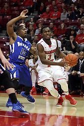 31 December 2014:  Daishon Knight turns towards the paint while guarded by Tre' Bennett during an NCAA Division 1 Missouri Valley Conference (MVC) men's basketball game between the Indiana State Sycamores beat the Illinois State Redbirds 63-61 at Redbird Arena in Normal Illinois