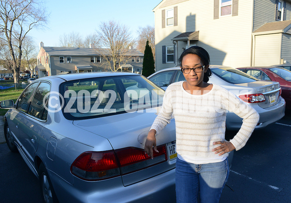 Nykeisha Johnson, of Warminster, Pennsylvania,  a recent recipient of a set of wheels through the Bucks County Opportunity Council's Wheelz to Work program stands near the car Monday November 16, 2015 in Warminster, Pennsylvania.  (Photo by William Thomas Cain)
