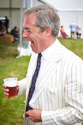 © Licensed to London News Pictures.  18/07/2014. WOODSTOCK, UK. UKIP leader Nigel Farage shares a pint with Ross Murray (not seen), deputy president of the Country Land & Business Association, during a visit to the CLA Game Fair being held at Blenheim Palace near Oxford. Over 150,000 people are expected to visit the event over the weekend.  <br /> <br /> Photo credit: Cliff Hide/LNP