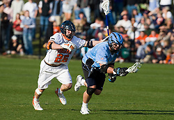 Johns Hopkins midfielder Stephen Peyser (12) beats Virginia midfielder Brian Mcdermott (26) on a faceoff.  The #2 ranked Virginia Cavaliers defeated the #6 ranked Johns Hopkins Blue Jays 13-12 in overtime at the University of Virginia's Klockner Stadium in Charlottesville, VA on March 22, 2008.  The loss, in front of a record UVA crowd of 7,500, was the third consecutive overtime defeat for Hopkins, the defending national champions.