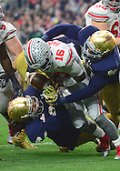 GLENDALE, AZ - JANUARY 01: Defensive lineman Romeo Okwara #45 of the Notre Dame Fighting Irish (right) and defensive lineman Sheldon Day #91 (left) hit quarterback J.T. Barrett #16 of the Ohio State Buckeyes during the first qurter of the BattleFrog Fiesta Bowl at University of Phoenix Stadium on January 1, 2016 in Glendale, Arizona.  (Photo by Jennifer Stewart/Getty Images)