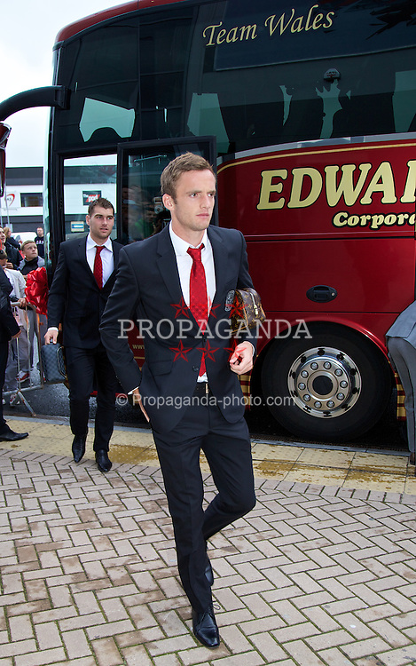 CARDIFF, WALES - Wednesday, August 14, 2013: Wales' Andy King arrives for the International Friendly against Republic of Ireland at the Cardiff City Stadium. (Pic by David Rawcliffe/Propaganda)