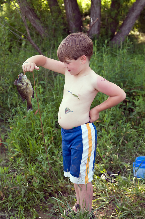 Fishing at Rick and Victoria's, photographed Thursday, May 23, 2010 in Waddy, Ky. (Photo by Brian Bohannon)