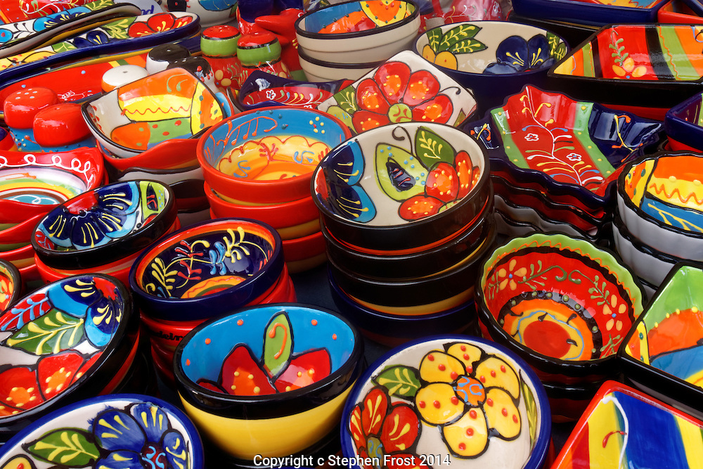 Colourful crockery photographed  on a market stall in Madeira.