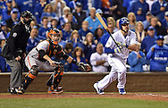 Oct 28, 2014; Kansas City, MO, USA; Kansas City Royals third baseman Mike Moustakas hits a RBI double against the San Francisco Giants in the second inning during game six of the 2014 World Series at Kauffman Stadium. Mandatory Credit: Peter G. Aiken-USA TODAY Sports
