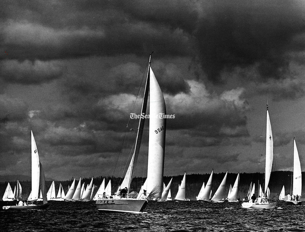 Racing is one of the most popular pastimes of Northwest sailors. Almost every weekend of the year, one or more sailing classes can be found competing on Puget Sound. This photo was captured just before the start of the 1977 Blakely Rock Race. The Blakely traditionally is the first major event of the racing season, held in early March. (Josef Scaylea / The Seattle Times, 1977)