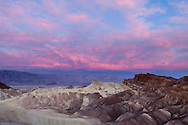 The sky turns pink at first light at Zabriskie Point, Death Valley National Park