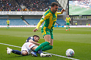 Millwall midfielder Ben Marshall (44) fouls West Bromwich Albion forward Hal Robson-Kanu (4) during the EFL Sky Bet Championship match between Millwall and West Bromwich Albion at The Den, London, England on 6 April 2019.
