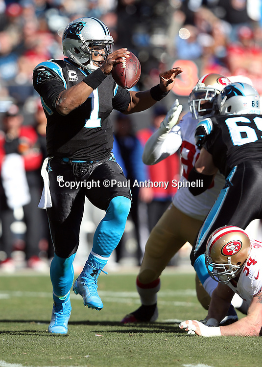 Carolina Panthers quarterback Cam Newton (1) high steps away from defensive pressure as he runs a keeper good for a first down on third down in the second quarter during the NFC Divisional Playoff NFL football game against the San Francisco 49ers on Sunday, Jan. 12, 2014 in Charlotte, N.C. The 49ers won the game 23-10. ©Paul Anthony Spinelli