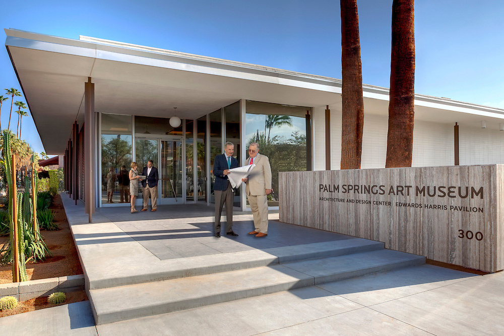 group of people with blueprint and ipad standing in front of the architectural and design center, palm springs, CA