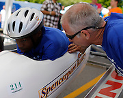 Craig Zaremba of Hamlin, right, offers some last-minute advice to Markus Graham at a local soapbox derby race on Lakeshore Boulevard in Irondequoit on Saturday, May 31, 2014. Eighty-two competitors raced in six divisions, with the winner of each division advancing to the world championships in Akron, Ohio.