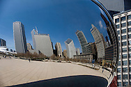 A photo of a Cloud Gate view of the Chicago skyline