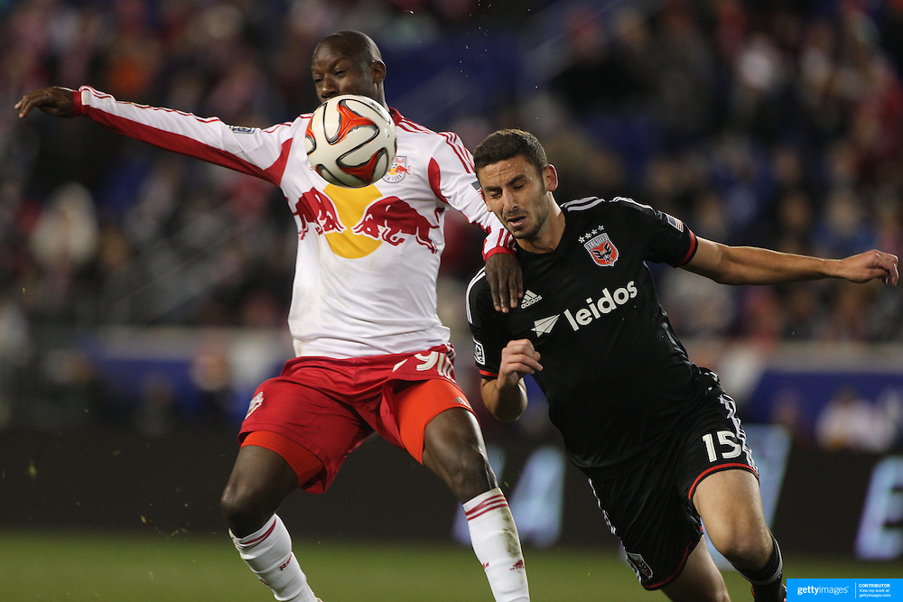 Bradley Wright-Phillips, (left), New York Red Bulls, is challenged by Steve Birnbaum, DC United, during the New York Red Bulls V DC United, MLS Cup Playoffs, Eastern Conference Semifinals first leg at Red Bull Arena, Harrison, New Jersey. USA. 2nd November 2014. Photo Tim Clayton