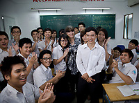 Ho Chi Minh 2012. Tran Van Giap teaching his Year 12 maths class at Truong Thpt school with Gabi Hollows.