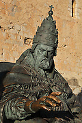 Statue of the Antipope Benedict XIII of Avignon, 1328-1423, known as 'El Papa Luna' or Pope Luna, 2007, by Sergio Blanco, in Peniscola, Valencia, Spain. Pope Luna moved the papal seat to Peniscola and lived in the Templar castle until his death in 1423. The statue is situated at the entrance to the Templar castle, Castell del Papa Luna. Picture by Manuel Cohen