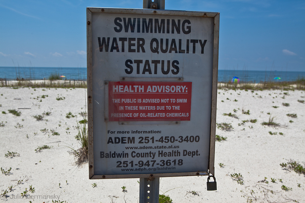 Sign wanring of the danger of oil in the water at Orange Beach from the BP oil spill.