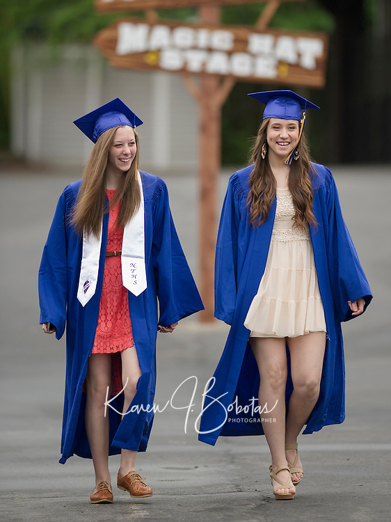 Emily Lamot and Summer McGaffigan are all smiles as they arrive at Meadowbrook Saturday morning for Gilford High School's commencement exercises.  (Karen Bobotas/for the Laconia Daily Sun)